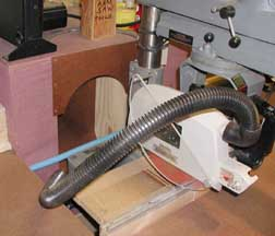 gene has redesigned and rebuilt the bin behind the radial arm saw to allow for proper sawdust collection attachments